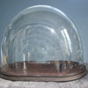 One of many shapes of antique hand-blown glass domes on bases