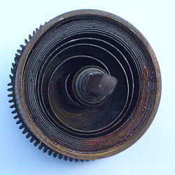 The teeth on this mainspring barrel have bent beyond safe repair because of the worn pivot hole